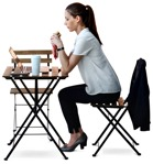 Cut out people - Businesswoman With A Computer Eating Seated 0003 | MrCutout.com