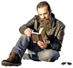 Cut out people - Man Reading A Book Sitting 0003 | MrCutout.com