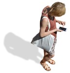 Cut out people - Woman With A Smartphone Standing 0012 | MrCutout.com